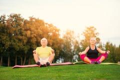 Senior couple doing yoga. Stock Photos