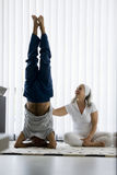 Senior couple doing yoga Stock Photos