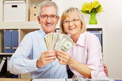 Senior couple with dollar bills Royalty Free Stock Image