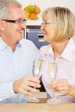 Senior couple drinking chapagne for New Year's Eve Royalty Free Stock Photography