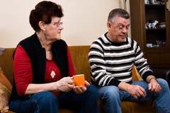 Senior couple drinking cofee in the livingroom Stock Photo
