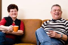 Senior couple drinking cofee and talking Stock Photos