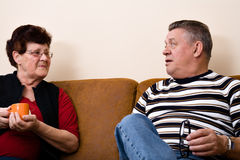 Senior couple drinking cofee and talking Royalty Free Stock Photo