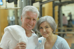 Senior couple drinking in gym Stock Image