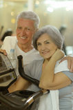 Senior couple drinking in gym Stock Photography
