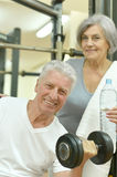 Senior couple drinking in gym Royalty Free Stock Images