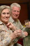 Senior couple drinking lemonade. And looking at camera Royalty Free Stock Images