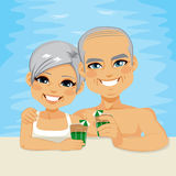 Senior Couple Drinking On Pool. Lovely senior couple drinking green cocktails relaxing on pool enjoying retirement vacation time together Stock Images