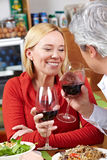 Senior couple drinking red wine. Happy senior couple drinking red wine in a restaurant Royalty Free Stock Photos