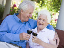 Senior couple drinking red wine Royalty Free Stock Photography