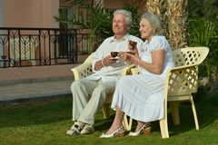 Senior Couple drinking tea in garden Stock Images