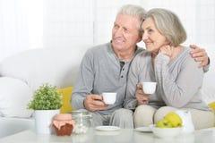 Senior couple drinking tea Stock Photo