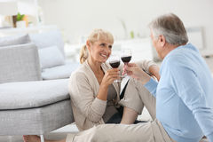 Senior couple drinking wine at home Stock Image