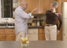 Senior couple drinkling, fighting Stock Images