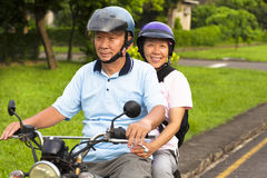 Senior couple drive motorcycle to travel. On a country road Stock Photos