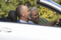 A senior couple driving a car Stock Photo