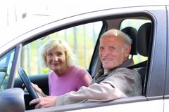 Senior couple driving the car Stock Photo