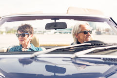 Senior Couple Driving A Convertible Classic Car Royalty Free Stock Photo