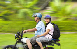 Senior couple driving motorcycle with dynamic background Royalty Free Stock Photo