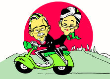 Senior couple driving a scooter Royalty Free Stock Images