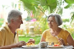 Senior couple eat outside at the resort Stock Photography