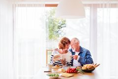 Senior couple eating breakfast at home. royalty free stock image