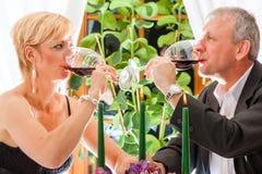 Senior couple eating dinner in restaurant Royalty Free Stock Photo