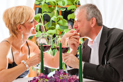 Senior couple eating dinner in restaurant Stock Images