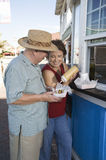 Senior Couple Eating Hot Dog Royalty Free Stock Images