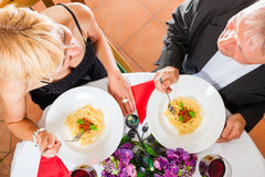 Senior couple eating Stock Images