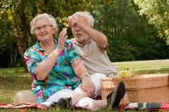 Senior couple eating some fruit royalty free stock photo