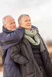Senior couple elderly people together outdoor. Happy senior couple elderly people together outdoor in autumn winter Royalty Free Stock Images