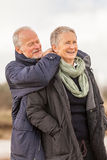 Senior couple elderly people together outdoor. Happy senior couple elderly people together outdoor in autumn winter Stock Image