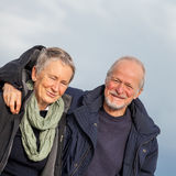 Senior couple elderly people together outdoor. Happy senior couple elderly people together outdoor in autumn winter Royalty Free Stock Image