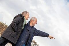Senior couple elderly people together outdoor. Happy senior couple elderly people together outdoor in autumn winter Stock Photo