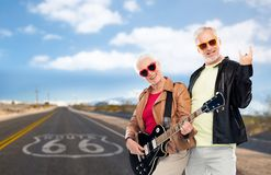Senior couple with electric guitar over route 66 Royalty Free Stock Photography