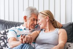 Senior couple embrace on sofa Stock Photography