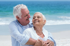 Senior couple embracing with arms around Royalty Free Stock Images
