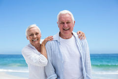Senior couple embracing at the beach Royalty Free Stock Photos