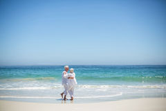 Senior couple embracing at the beach Royalty Free Stock Photo