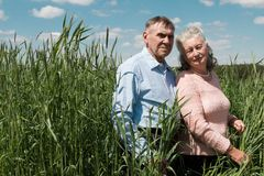 Senior couple embracing each other in countryside Royalty Free Stock Photography