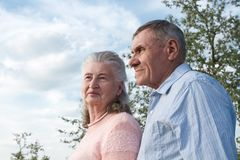 Senior couple embracing each other in countryside Stock Images