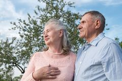 Senior couple embracing each other in countryside Royalty Free Stock Photo