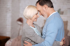 Senior couple embracing each other royalty free stock images