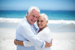 Senior couple embracing head to head Stock Photos