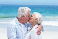 Senior couple embracing and kissing Stock Photos