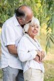 Senior couple embracing and kissing Stock Photo