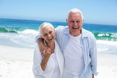 Senior couple embracing and looking the camera Royalty Free Stock Photo