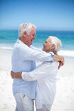 Senior couple embracing and looking at each other Stock Photo