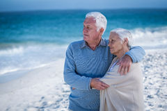 Senior couple embracing and looking the sea Stock Photo